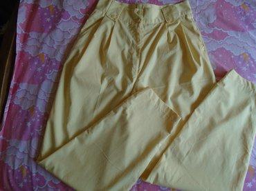 Limun žute, vintage, duboke pantalone, veličine 42. Nošene su - Belgrade